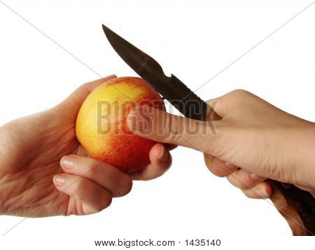 Closeup Of Hands Cutting Apple With Sharp Hunter'S Knife