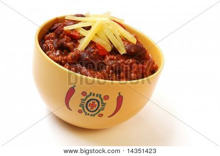 A bowl of home made chili, with beans and grated cheese.