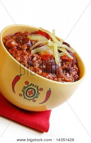 A bowl of chilli with beans, topped with grated cheese.