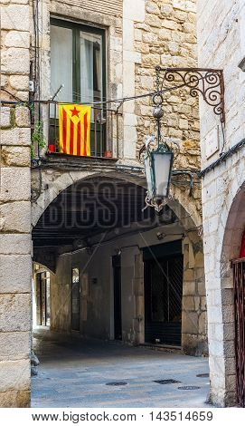 Flag Of Catalonia In The Downtown Of Girona. Spain.