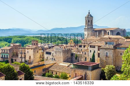 The medieval quarter of Gerona with bell tower of Santa Maria cathedral in background. View from The Forca Vella. Gerona Costa Brava Catalonia Spain.
