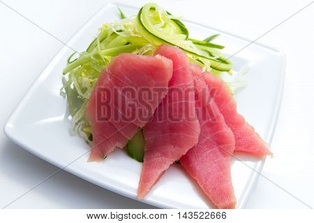 tunny with cucumber and cabbage salad isolated in white