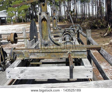 A restored turpentine still at St. Andrews State Park Panama City Florida includes the sawmill used to cut wood for the distilling process.