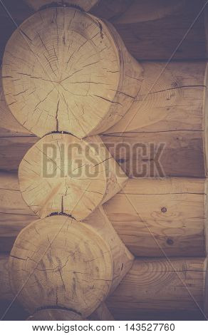 Corner joint on a log cabin - Rustic image with details of a wooden cabin corner, with logs joined together with a great construction technique.