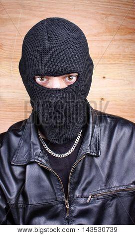 Masked thief in balaclava bandit gangster mafia
