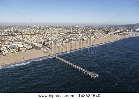 Hermosa Beach, California, USA - August 16, 2016:  Aerial view of Hermosa Beach Pier and the Pacific Ocean in Southern California.