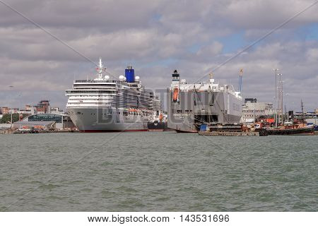 Southampton/UK. 21st August 2016. Cruise ship Arcadia is moored up in Southampton prior to an afternoon cruise to Europe. A car transporter ship occupies the other berth to the right.