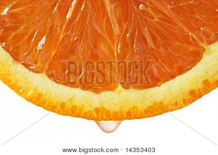 Drop of juice falling from blood orange.