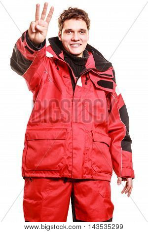 Male outdoorsman making gestures. Young man with weatherproof gear. Communication outdoor adventure danger concept.