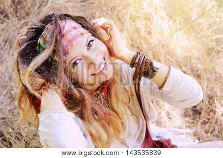 Smiling happy hippie woman outdoor portrait, looking at camera. Boho, indie style