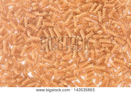 Organic italian rice pasta on white background