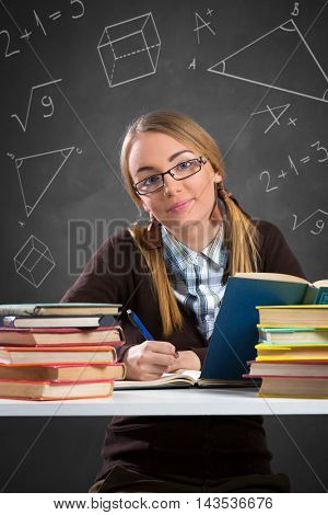 Cheerful girl siting front open books and learning