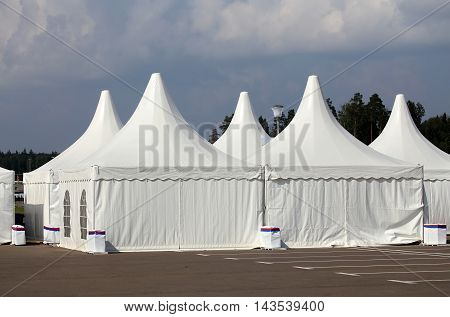 White tents at the exhibition camp appointed as pavilions