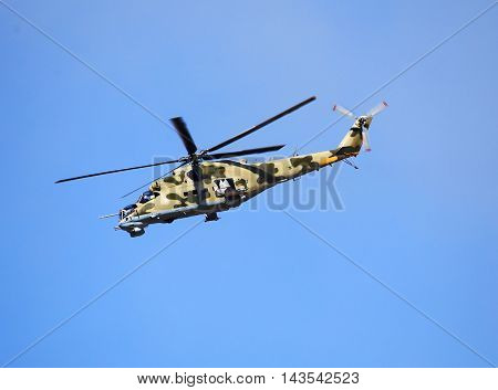 Perform flight by the modern russian attack helicopter Mi 24