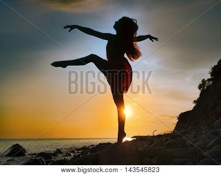 dance on the beach. Sunset. Quiet evening