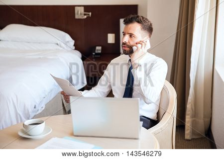 Busy Businessman Talking To Client In A Hotel