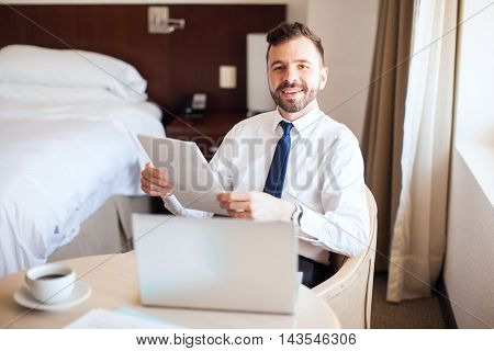 Happy Businessman Working On A Business Trip