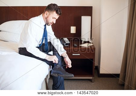 Businessman Getting Dressed In A Hotel