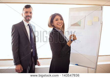 Cute Businesswoman Preparing A Presentation