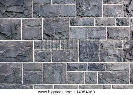 Old wall of bluestone blocks.  This stone is common in early buildings in Melbourne, Australia.