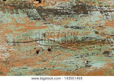 Rustic wooden board with peeled paint and texture