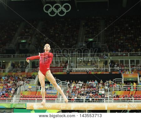RIO DE JANEIRO, BRAZIL - AUGUST 11, 2016: Olympic champion Aly Raisman of United States competing on the balance beam at women's all-around gymnastics at Rio 2016 Olympic Games