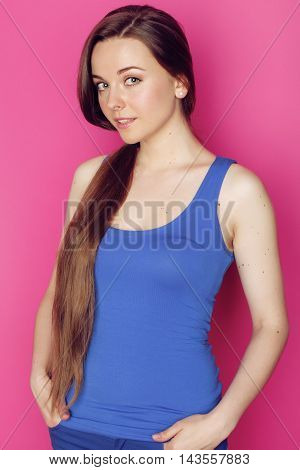 young happy slim girl with skipping rope on pink background smiling sweety cute glamour