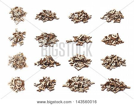 Pile of wooden letters isolated over the white background, set of multiple different foreshortenings