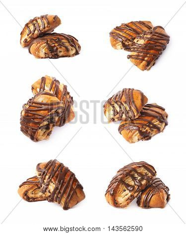 Two roll pastry buns covered with the chocolate, composition isolated over the white background, set of six different foreshortenings