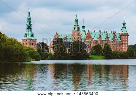 Frederiksborg castle reflected in the lake in Hillerod Denmark. Renaissance castle and romantic lake near Copenhagen. poster