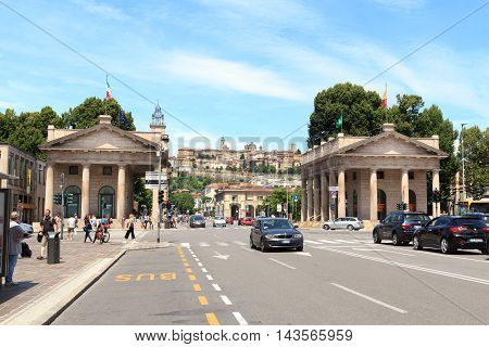 Bergamo, Italy - June 21, 2016: Portal Porta Nuova and upper city Citta Alta. The portal is the gateway to the Lower Town and was built in 1837.