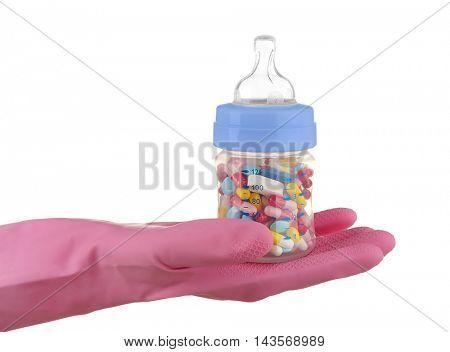 Hand in glove holding feeding bottle full of pills on white background
