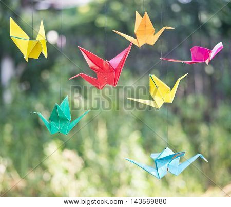 close up of an origami paper birds