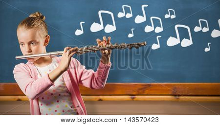 Girl playing german flute against blackboard