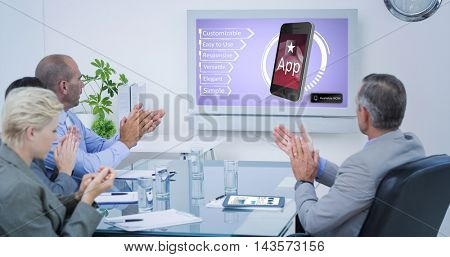 Business team applauding and looking at white screen against ad for a new application