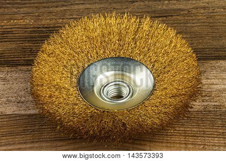 the new metal brush on wooden background