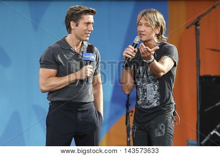 NEW YORK-AUG 12: David Muir (L) and Keith Urban onstage at ABC's