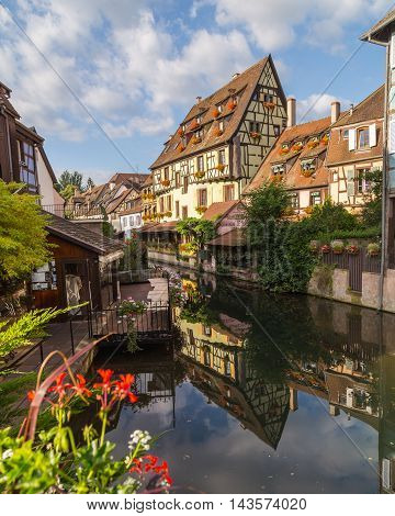 COLMAR FRANCE - 30TH JULY 2016: A view of colourful timber framed buildings near Rue Turenne at La Petite Venise in Colmar during the morning
