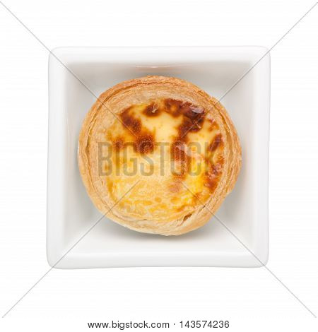 Egg tart in a square bowl isolated on white background