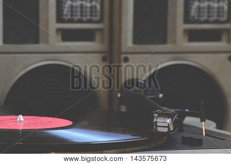 Old vinyl player and records on the table