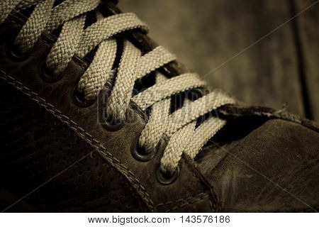 The laces on old and dirty sneakers