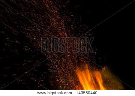 Fire flames on a black background. Blaze fire flame texture background. Close up of fire flames isolated on black background. Burn. Abstract fire flames background. Texture.