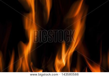Fire flames on a black background. Blaze fire flame texture background. Close up of fire flames isolated on black background. Burn. Abstract fire flames background. Texture. poster