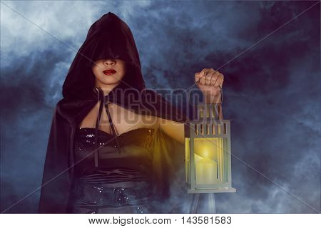 Halloween Witch Woman Holding Lantern