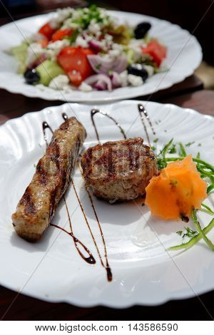 Kebapche and kyufte - a traditional Bulgarian dish of grilled minced meat with spices.