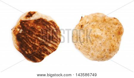 Cottage cheese flapjack flat cake isolated over the white background, set of two different foreshortenings top and bottom sides