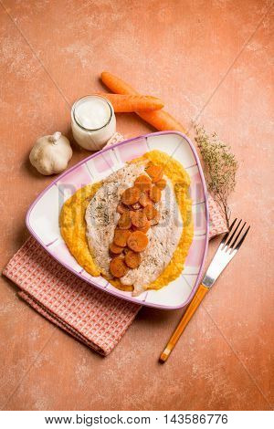escalope with yogurt sauce and carrot puree