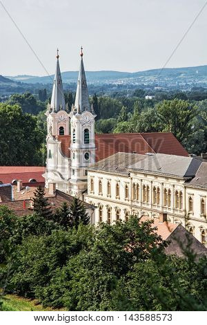Saint Ignatius church view from Esztergom basilica Hungary. Travel destination. Cultural heritage. Urban scene. Religious architecture. Danube river. Vertical composition.