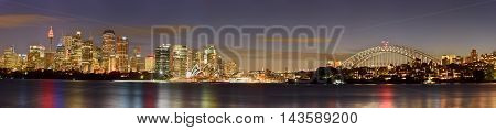 SYDNEY AUSTRALIA - August 212016: View panorama of Sydney CBD and The Opera House on sunset Sydney Australia Over 10 millions tourists visit Sydney every year