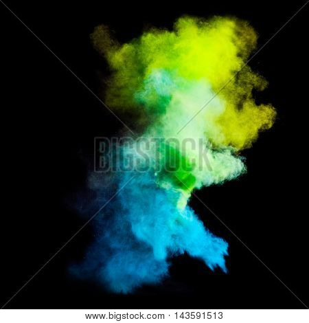 Colorful powders on black background. Freeze motion of colored dust